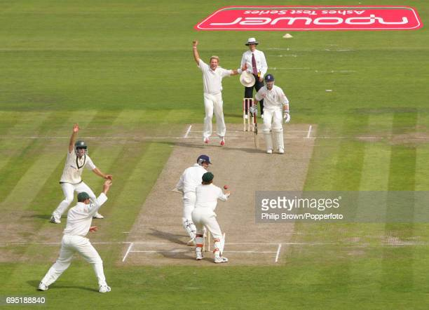 Shane Warne of Australia watches as teammate Adam Gilchrist takes the catch to dismiss Marcus Trescothick of England to give Warne his 600th Test...