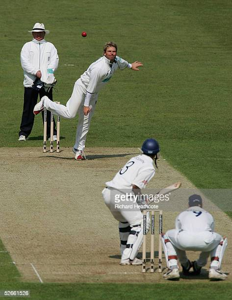 Shane Warne of Hampshire bowls to Murray Goodwin of Sussex during the Frizzell County Championship Division 1 match between Sussex and Hampshire at...