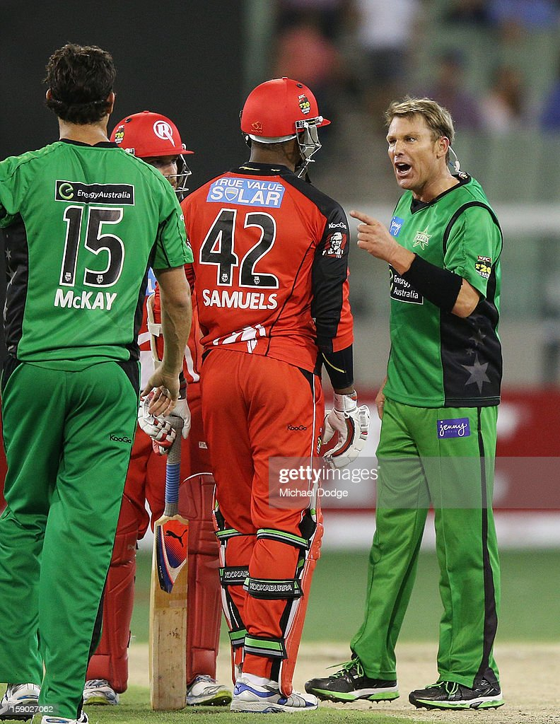<a gi-track='captionPersonalityLinkClicked' href=/galleries/search?phrase=Shane+Warne&family=editorial&specificpeople=167242 ng-click='$event.stopPropagation()'>Shane Warne</a> (R) of the Melbourne Stars has a heated exchange with <a gi-track='captionPersonalityLinkClicked' href=/galleries/search?phrase=Marlon+Samuels&family=editorial&specificpeople=185235 ng-click='$event.stopPropagation()'>Marlon Samuels</a> of the Melbourne Renegades during the Big Bash League match between the Melbourne Stars and the Melbourne Renegades at Melbourne Cricket Ground on January 6, 2013 in Melbourne, Australia.