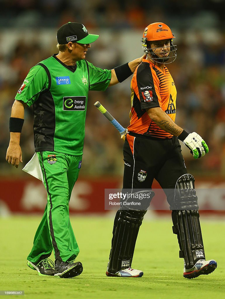 Shane Warne of the Stars acknowedges Herschelle Gibbs of the Perth Scorchers as he leaves the ground with an injury during the Big Bash League semi-final match between the Perth Scorchers and the Melbourne Stars at the WACA on January 16, 2013 in Perth, Australia.