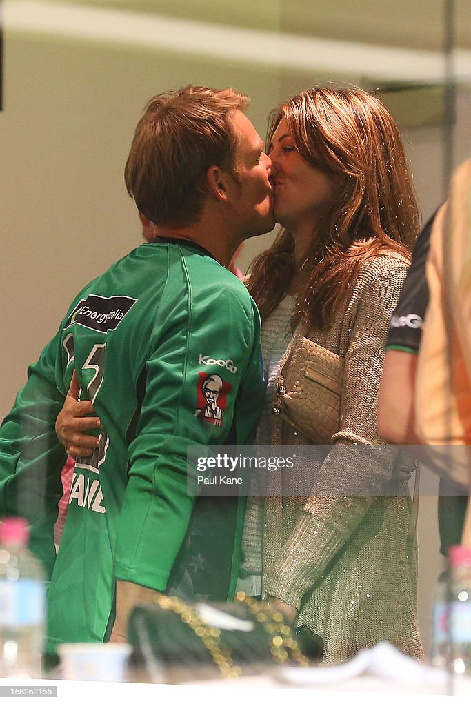 Shane Warne of the Stars kisses Liz Hurley in the players rooms after winning the Big Bash League match between the Perth Scorchers and the Melbourne Stars at WACA on December 12, 2012 in Perth, Australia.