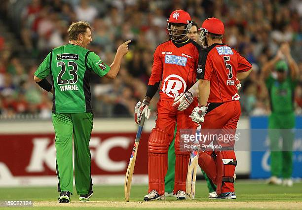 Shane Warne of the Stars points his finger towards Marlon Samuels of the Stars during the Big Bash League match between the Melbourne Stars and the...