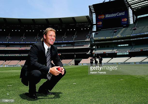 Shane Warne poses for photographers in the centre of the MCG after he announces his retirement from international cricket during a press conference...