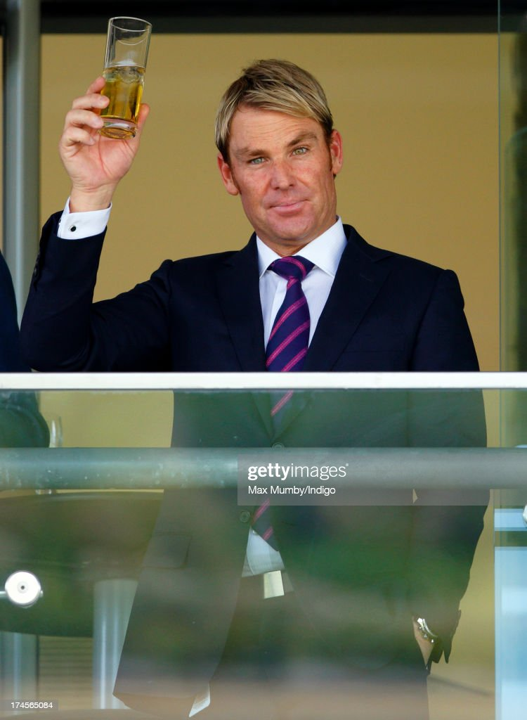 <a gi-track='captionPersonalityLinkClicked' href=/galleries/search?phrase=Shane+Warne&family=editorial&specificpeople=167242 ng-click='$event.stopPropagation()'>Shane Warne</a> raises his glass whilst watching the racing as he and Elizabeth Hurley attend the Betfair Weekend, featuring the King George VI and Queen Elizabeth Stakes, at Ascot Racecourse on July 27, 2013 in Ascot, England.