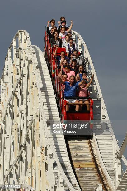 Shane Warne rides the scenic railway with children during the Shane Warne Foundation Family Day at Luna Park on December 3 2013 in Melbourne Australia