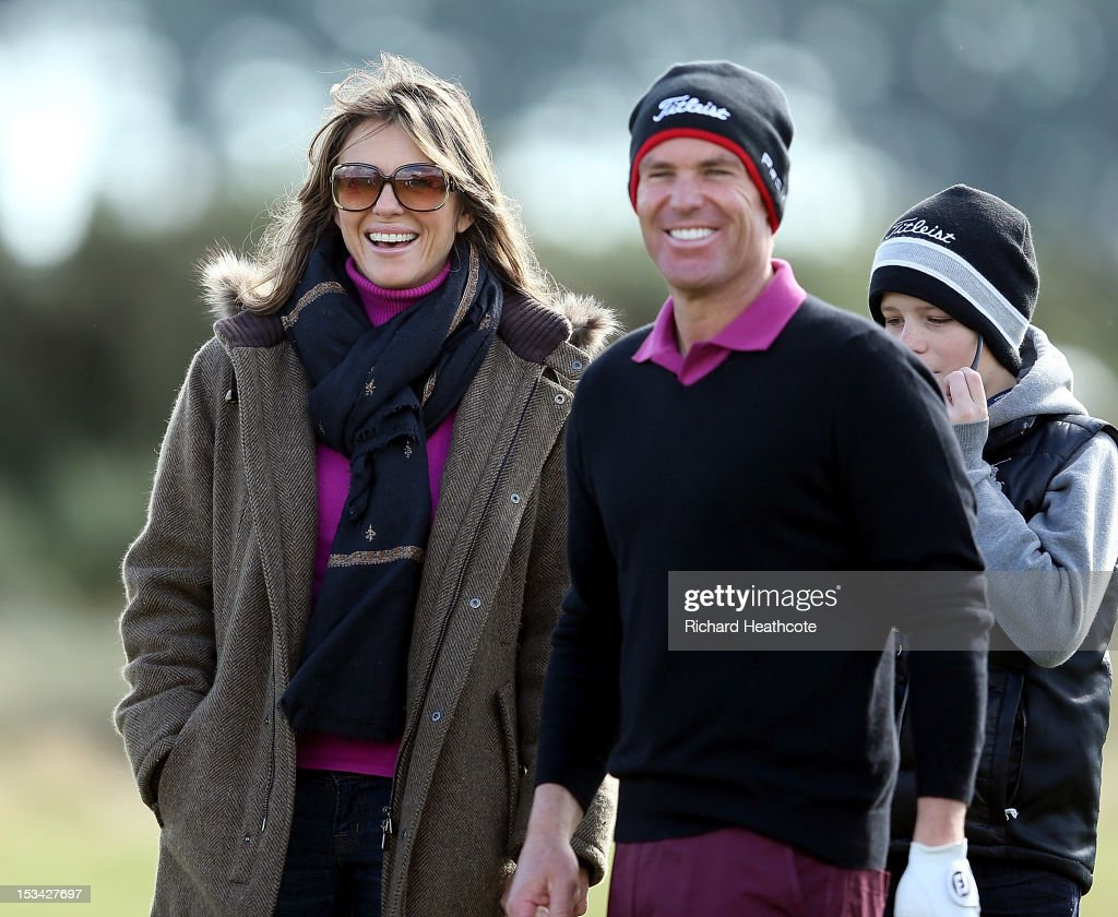 <a gi-track='captionPersonalityLinkClicked' href=/galleries/search?phrase=Shane+Warne&family=editorial&specificpeople=167242 ng-click='$event.stopPropagation()'>Shane Warne</a> with his partner <a gi-track='captionPersonalityLinkClicked' href=/galleries/search?phrase=Elizabeth+Hurley&family=editorial&specificpeople=201731 ng-click='$event.stopPropagation()'>Elizabeth Hurley</a> during the second round of The Alfred Dunhill Links Championship at Carnoustie Golf Links on October 5, 2012 in Carnoustie, Scotland.