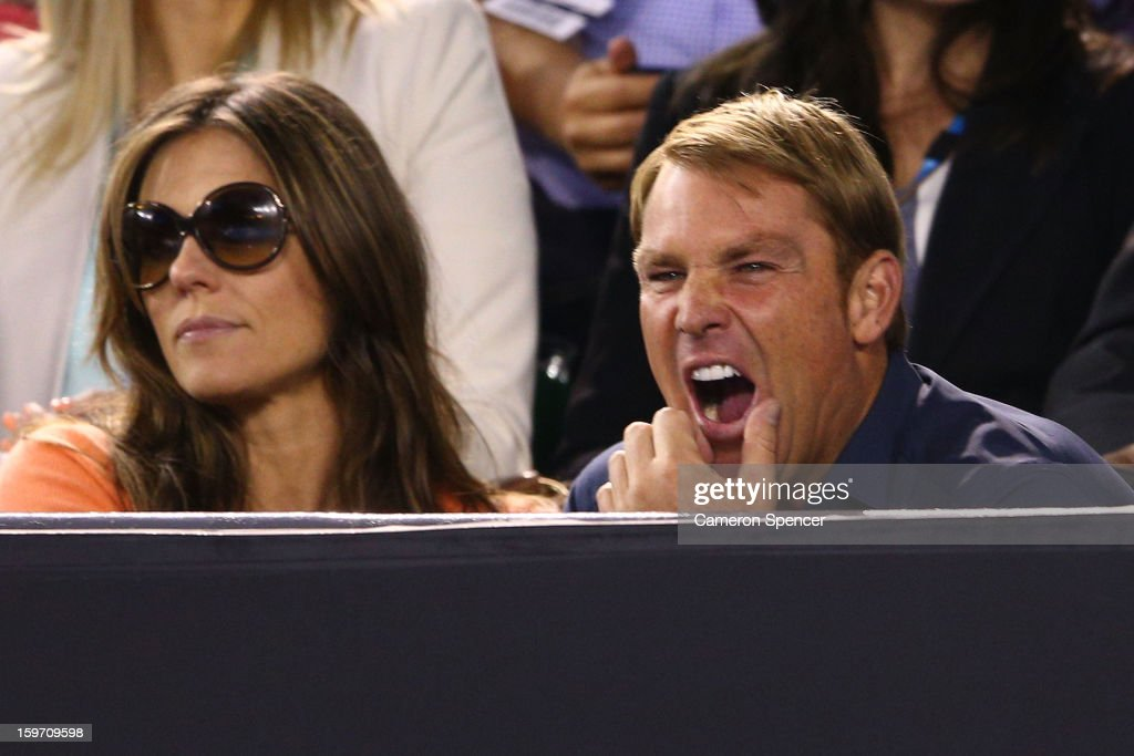 Shane Warne yawns at the men's third round match between Roger Federer of Switzerland and Bernard Tomic of Australia during day six of the 2013 Australian Open at Melbourne Park on January 19, 2013 in Melbourne, Australia.