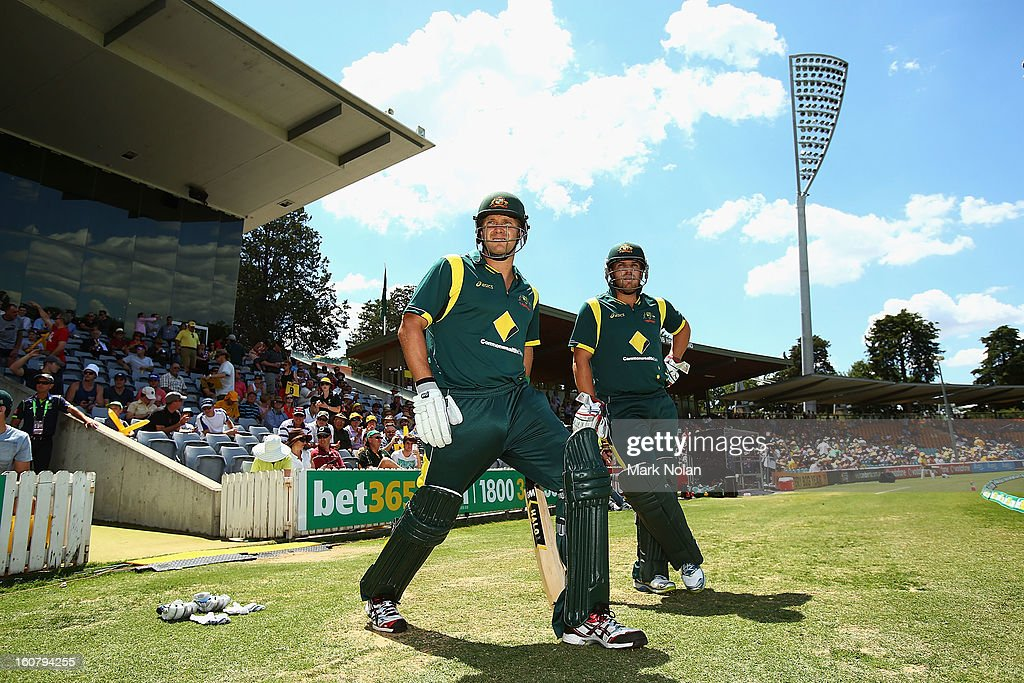 Shane Watson and Aaron Finch of Australia prepare to bat during the Commonwealth Bank One Day International Series between Australia and the West Indies at Manuka Oval on February 6, 2013 in Canberra, Australia.