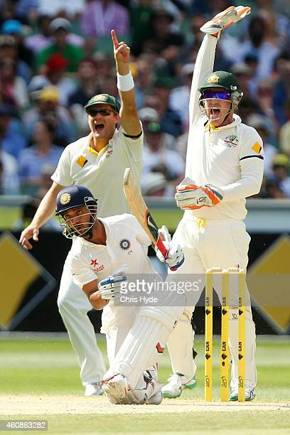 Shane Watson and Brad Haddin of Australia celebrate after Ajinkya Rahane of India is dismissed by Nathan Lyon during day three of the Third Test...