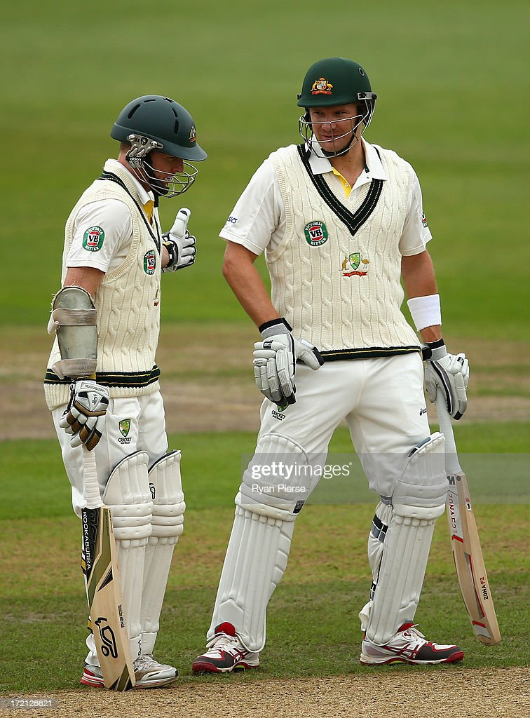 Shane Watson and Chris Rogers of Australia talk as they opening the batting during day one of the Tour Match between Worcestershire and Australia at New Road on July 2, 2013 in Worcester, England.
