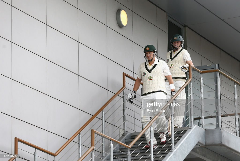 <a gi-track='captionPersonalityLinkClicked' href=/galleries/search?phrase=Shane+Watson+-+Cricket+Player&family=editorial&specificpeople=171874 ng-click='$event.stopPropagation()'>Shane Watson</a> and <a gi-track='captionPersonalityLinkClicked' href=/galleries/search?phrase=Chris+Rogers+-+Cricket+Player&family=editorial&specificpeople=178255 ng-click='$event.stopPropagation()'>Chris Rogers</a> of Australia walk out to open the batting during day one of the Tour Match between Worcestershire and Australia at New Road on July 2, 2013 in Worcester, England.