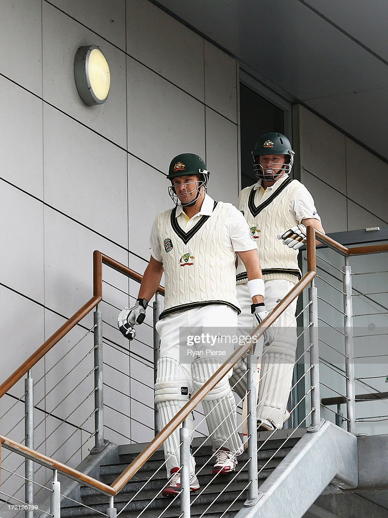 Shane Watson and Chris Rogers of Australia walk out to open the batting during day one of the Tour Match between Worcestershire and Australia at New Road on July 2, 2013 in Worcester, England.