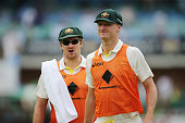 Shane Watson and Jackson Bird of Australia run drinks onto the field during day two of the Second Test match between South Africa and Australia at...