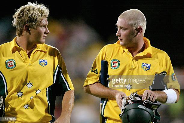 Shane Watson and Michael Clarke of Australia come off the ground after hitting the winning runs during the VB series One Day International match...