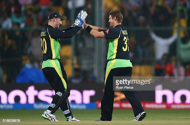 Shane Watson and Peter Nevill of Australia celebrate after taking the wicket of Soumya Sarker of Bangladesh during the ICC World Twenty20 India 2016...