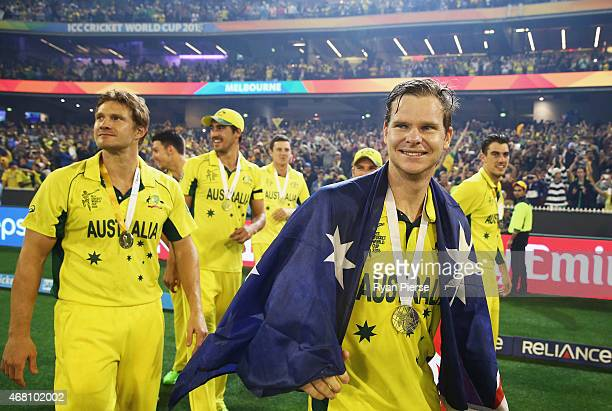 Shane Watson and Steve Smith of Australia celebrate during the 2015 ICC Cricket World Cup final match between Australia and New Zealand at Melbourne...