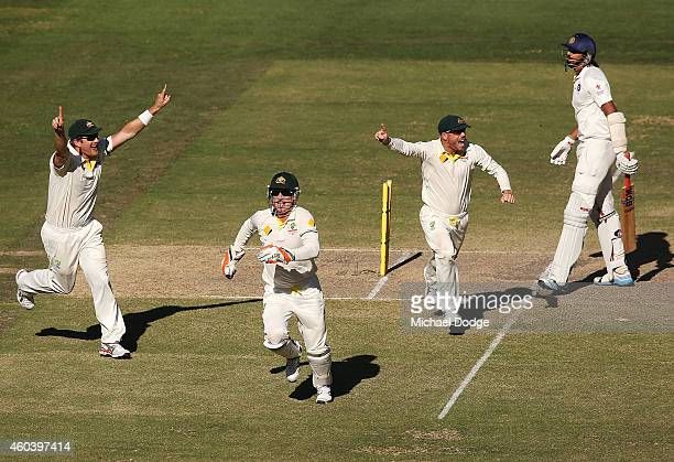 Shane Watson Brad Haddin and David Warner of Australia celebrate winning the match after Ishant Sharma of India was dismissed during day five of the...