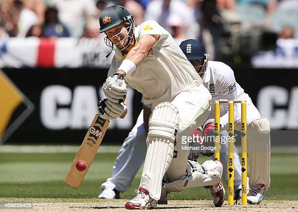 Shane Watson hits the winning runs during day four of the Fourth Ashes Test Match between Australia and England at Melbourne Cricket Ground on...