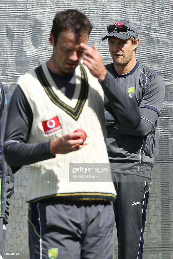 Shane Watson (R) looks on as Rob Quiney prepares to bowl during an Australian training session at Adelaide Oval on November 21, 2012 in Adelaide, Australia.