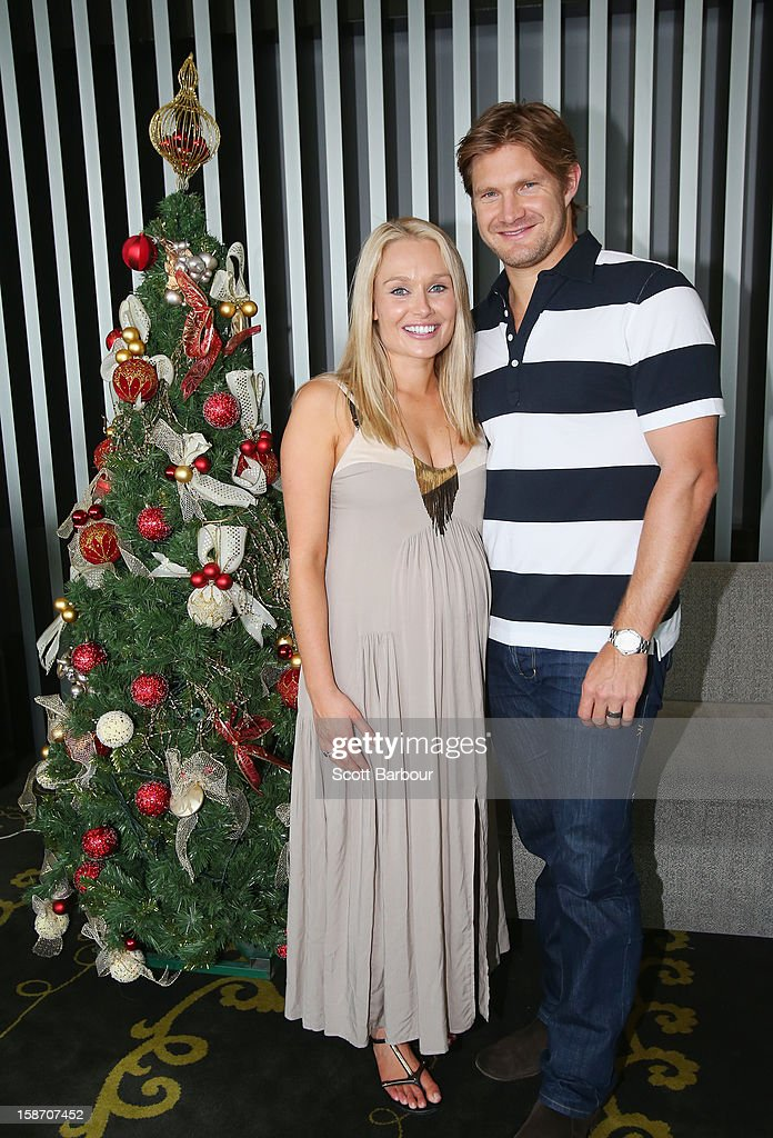 Shane Watson of Australia and his pregnant wife Lee Furlong pose next to a Christmas tree ahead of a Cricket Australia Christmas Day lunch at Crown Entertainment Complex on December 25, 2012 in Melbourne, Australia.