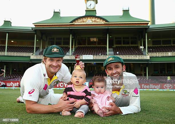 Shane Watson of Australia and his son Will and Nathan Lyon of Australia and daughter Harper Lyon pose with the urn after day three of the Fifth Ashes...