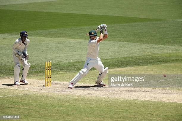 Shane Watson of Australia bats in front of Wriddhiman Saha of India during day four of the First Test match between Australia and India at Adelaide...