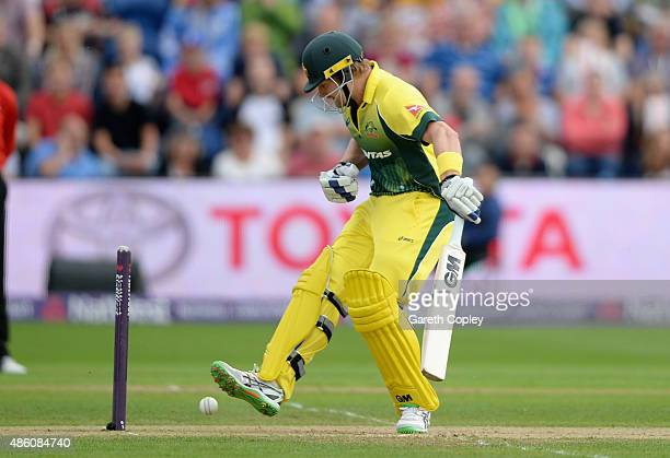 Shane Watson of Australia can't stop the ball as he is bowled by Steven Finn of England during the NatWest T20 International match between England...