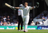 Shane Watson of Australia celebrates his century during day one of the 5th Investec Ashes Test match between England and Australia at the Kia Oval on...