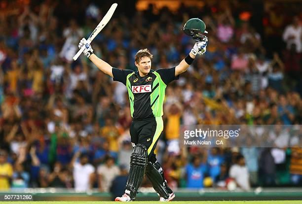 Shane Watson of Australia celebrates his century during the International Twenty20 match between Australia and India at Sydney Cricket Ground on...
