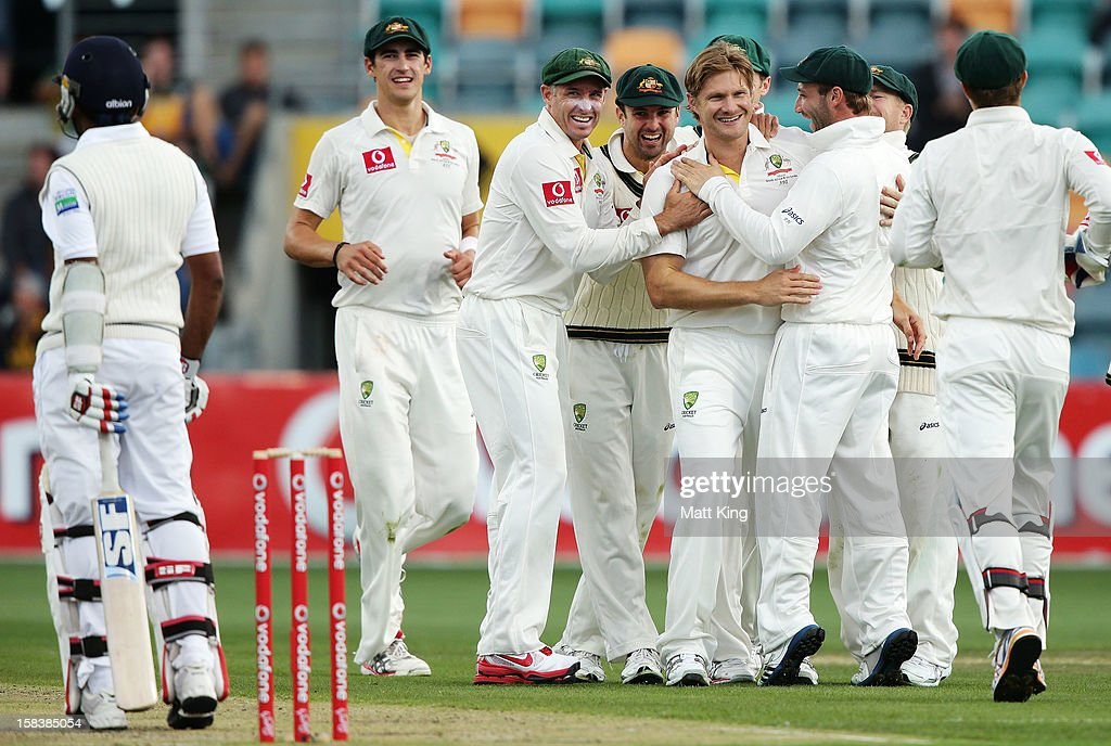 Shane Watson of Australia celebrates taking the wicket of Mahela Jayawardene of Sri Lanka during day two of the First Test match between Australia and Sri Lanka at Blundstone Arena on December 15, 2012 in Hobart, Australia.