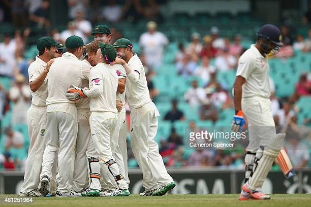 Shane Watson of Australia celebrates with captain Steve Smith and team mates after dismissing Rohit Sharma of India during day five of the Fourth...