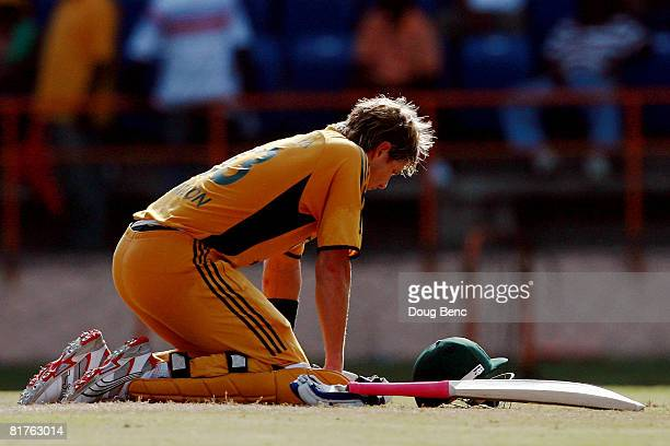 Shane Watson of Australia collapses to his knees for a water break during the OneDay International game three match between Australia and West Indies...