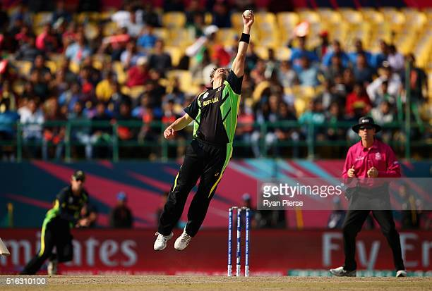 Shane Watson of Australia fields off his own bowling during the ICC World Twenty20 India 2016 Super 10s Group 2 match between Australia and New...