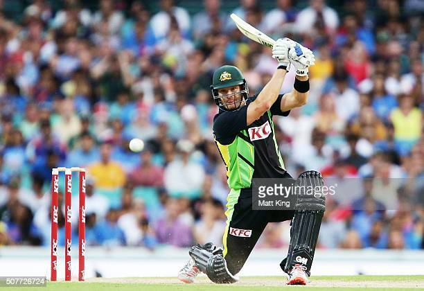 Shane Watson of Australia hits a four during the International Twenty20 match between Australia and India at Sydney Cricket Ground on January 31 2016...