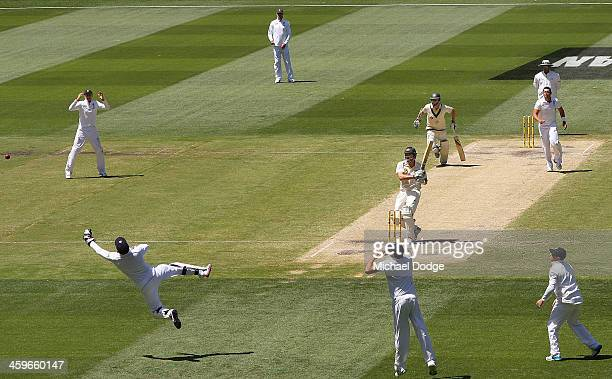 Shane Watson of Australia hits the ball past Jonny Bairstow of England off the bowling of Tim Bresnan during day four of the Fourth Ashes Test Match...