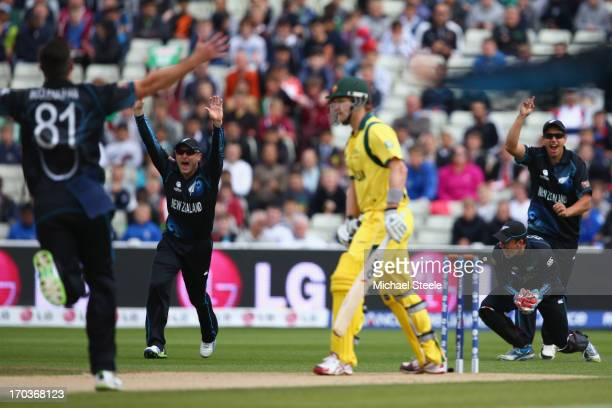 Shane Watson of Australia is caught behind by wicketkeeper Luke Ronchi off the bowling of Mitchell McClenaghan of New Zealand during the ICC...