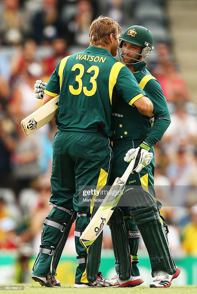 Shane Watson (L) of Australia is congratulated by Phil Hughes after scoring a century during the Commonwealth Bank One Day International Series between Australia and the West Indies at Manuka Oval on February 6, 2013 in Canberra, Australia.