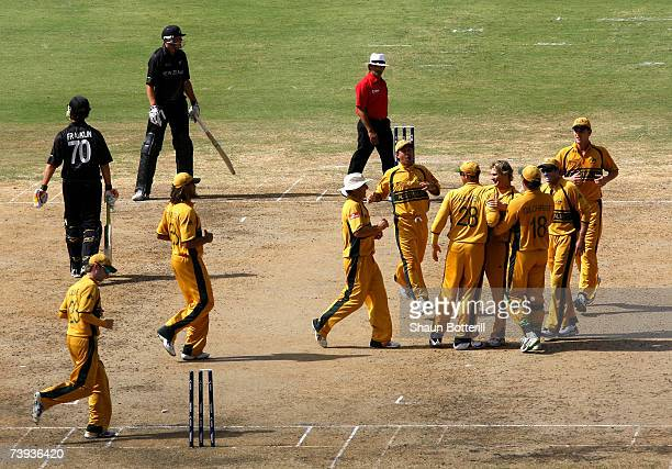 Shane Watson of Australia is congratulated by teammates after bowling out James Franklin of New Zealand during the ICC Cricket World Cup 2007 Super...