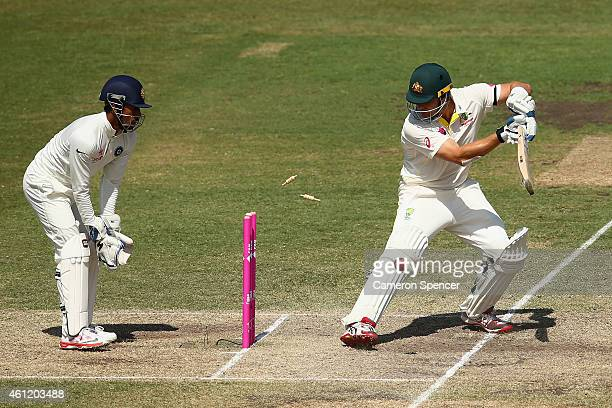 Shane Watson of Australia is dismissed by Ravichandran Ashwin of India during day four of the Fourth Test match between Australia and India at Sydney...