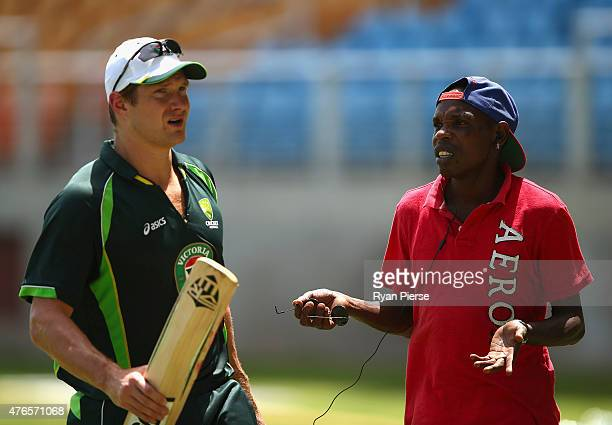 Shane Watson of Australia is spoken to by a local wanting match tickets during an Australian nets session at Sabina Park on June 10 2015 in Kingston...
