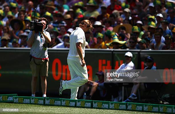 Shane Watson of Australia leaves the ground with a leg injury during day one of the Fourth Ashes Test Match between Australia and England at...