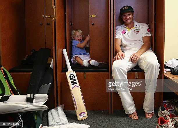 Shane Watson of Australia poses with his son Will in the change rooms after day five of the Fourth Test match between Australia and India at Sydney...