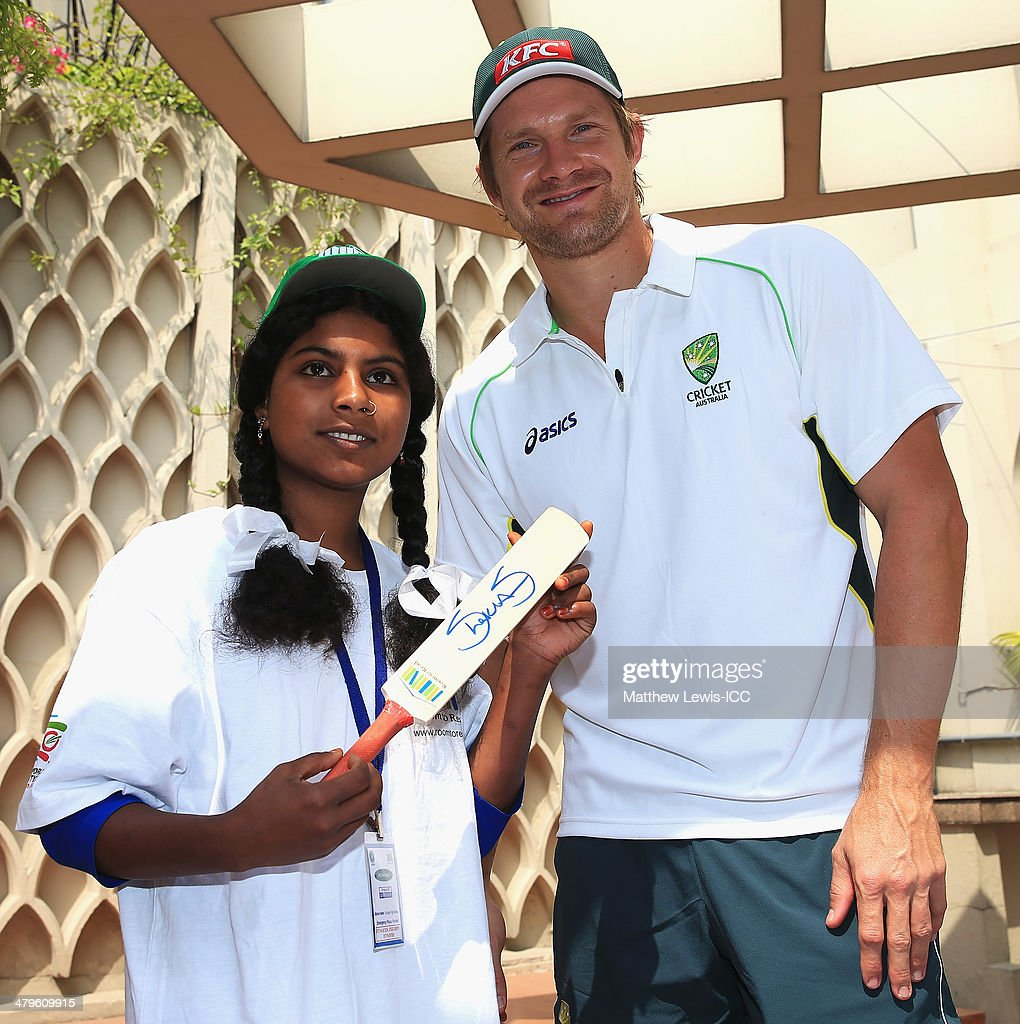 <a gi-track='captionPersonalityLinkClicked' href=/galleries/search?phrase=Shane+Watson+-+Cricket+Player&family=editorial&specificpeople=171874 ng-click='$event.stopPropagation()'>Shane Watson</a> of Australia presents signed mini cricket bats to local school children during an ICC CSR event at the Ruposhi Bangla Hotel on March 20, 2014 in Dhaka, Bangladesh.