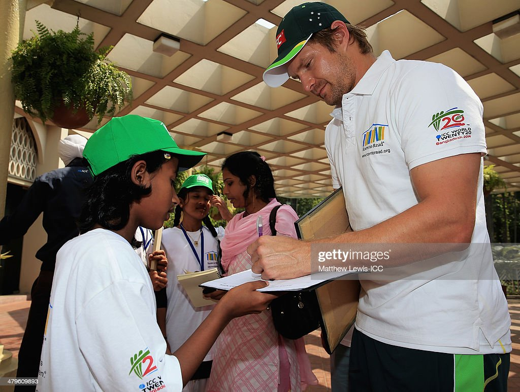 Shane Watson of Australia signs autographs for local school children during an ICC CSR event at the Ruposhi Bangla Hotel on March 20, 2014 in Dhaka, Bangladesh.