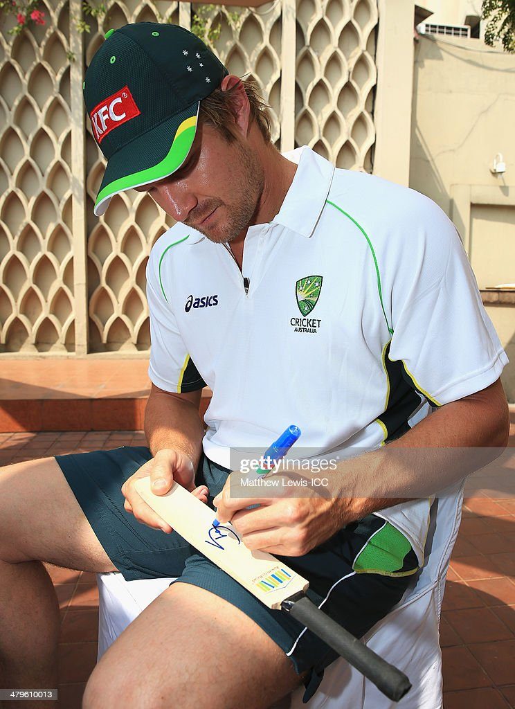 <a gi-track='captionPersonalityLinkClicked' href=/galleries/search?phrase=Shane+Watson+-+Cricket+Player&family=editorial&specificpeople=171874 ng-click='$event.stopPropagation()'>Shane Watson</a> of Australia signs mini cricket bats for local school children during an ICC CSR event at the Ruposhi Bangla Hotel on March 20, 2014 in Dhaka, Bangladesh.