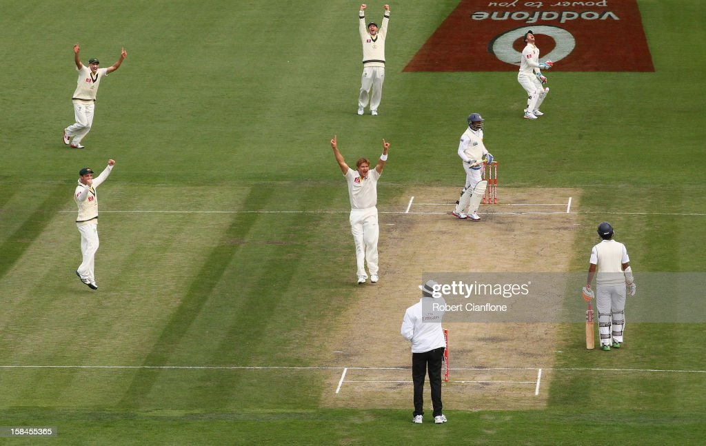 <a gi-track='captionPersonalityLinkClicked' href=/galleries/search?phrase=Shane+Watson+-+Cricket+Player&family=editorial&specificpeople=171874 ng-click='$event.stopPropagation()'>Shane Watson</a> of Australia takes the wicket of <a gi-track='captionPersonalityLinkClicked' href=/galleries/search?phrase=Tillakaratne+Dilshan&family=editorial&specificpeople=239186 ng-click='$event.stopPropagation()'>Tillakaratne Dilshan</a> of Sri Lanka during day four of the First Test match between Australia and Sri Lanka at Blundstone Arena on December 17, 2012 in Hobart, Australia.