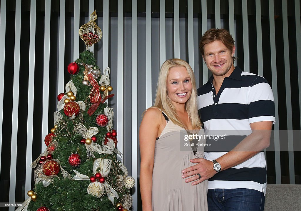 <a gi-track='captionPersonalityLinkClicked' href=/galleries/search?phrase=Shane+Watson+-+Cricket+Player&family=editorial&specificpeople=171874 ng-click='$event.stopPropagation()'>Shane Watson</a> of Australia touches the stomach of his pregnant wife <a gi-track='captionPersonalityLinkClicked' href=/galleries/search?phrase=Lee+Furlong&family=editorial&specificpeople=579330 ng-click='$event.stopPropagation()'>Lee Furlong</a> as they pose next to a Christmas tree ahead of a Cricket Australia Christmas Day lunch at Crown Entertainment Complex on December 25, 2012 in Melbourne, Australia.