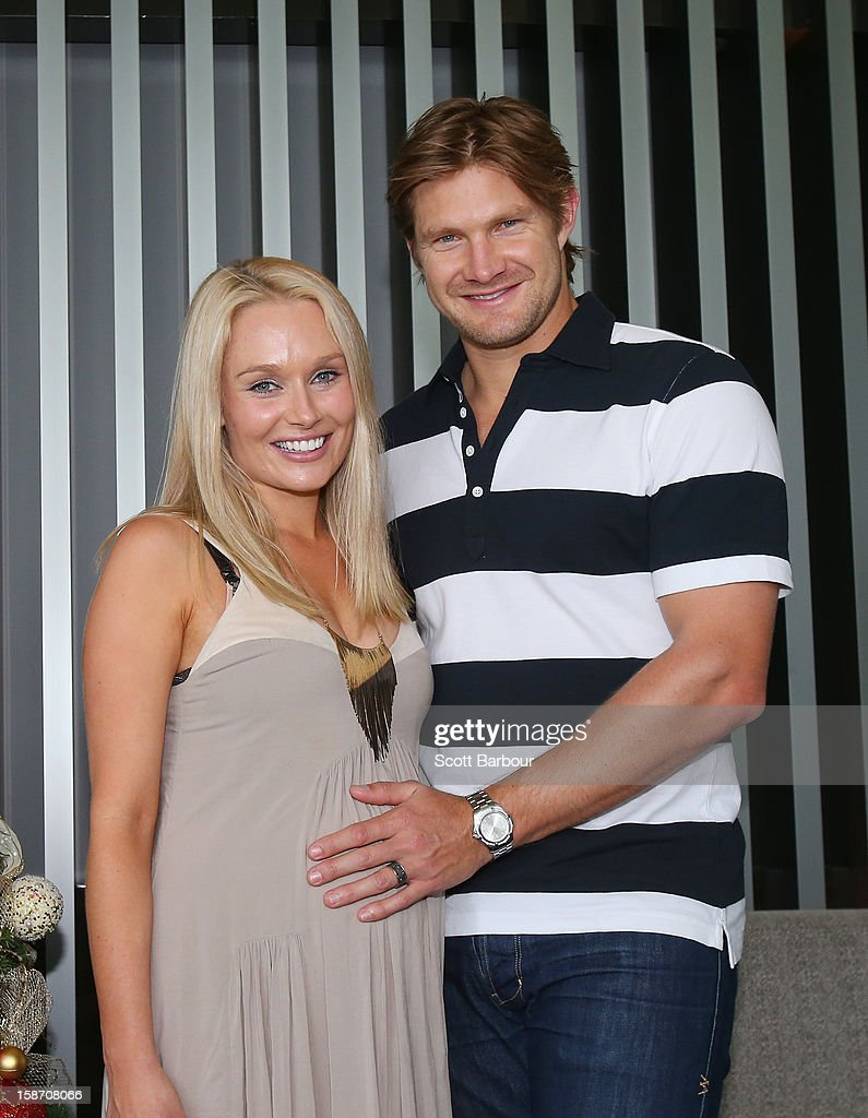 Shane Watson of Australia touches the stomach of his pregnant wife Lee Furlong as they pose next to a Christmas tree ahead of a Cricket Australia Christmas Day lunch at Crown Entertainment Complex on December 25, 2012 in Melbourne, Australia.