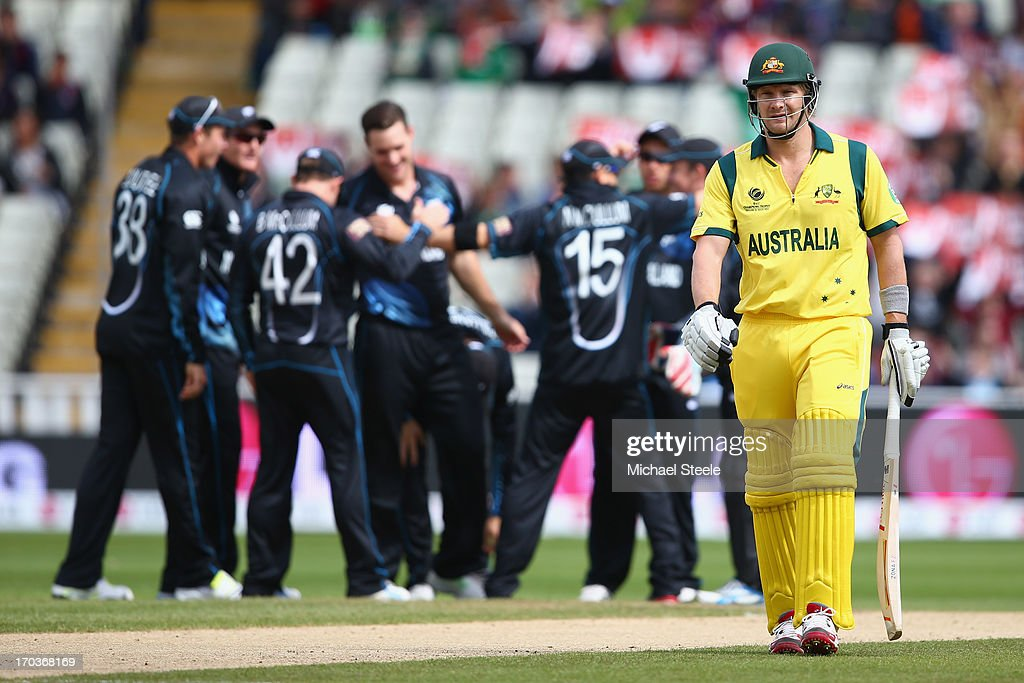 <a gi-track='captionPersonalityLinkClicked' href=/galleries/search?phrase=Shane+Watson+-+Cricket+Player&family=editorial&specificpeople=171874 ng-click='$event.stopPropagation()'>Shane Watson</a> (R) of Australia walks back to the pavillion after being icaught behind by wicketkeeper Luke Ronchi off the bowling of Mitchell McClenaghan of New Zealand during the ICC Champions Trophy Group A match between Australia and New Zealand at Edgbaston on June 12, 2013 in Birmingham, England.