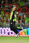 Shane Watson of the Thunder celebrates catching Sean Abbott of the Sixers off his own delivery during the Big Bash League match between the Sydney...